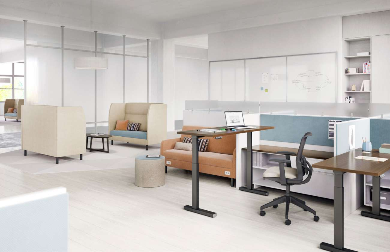 open concept office with lounge area and work stations with adjustable height tables