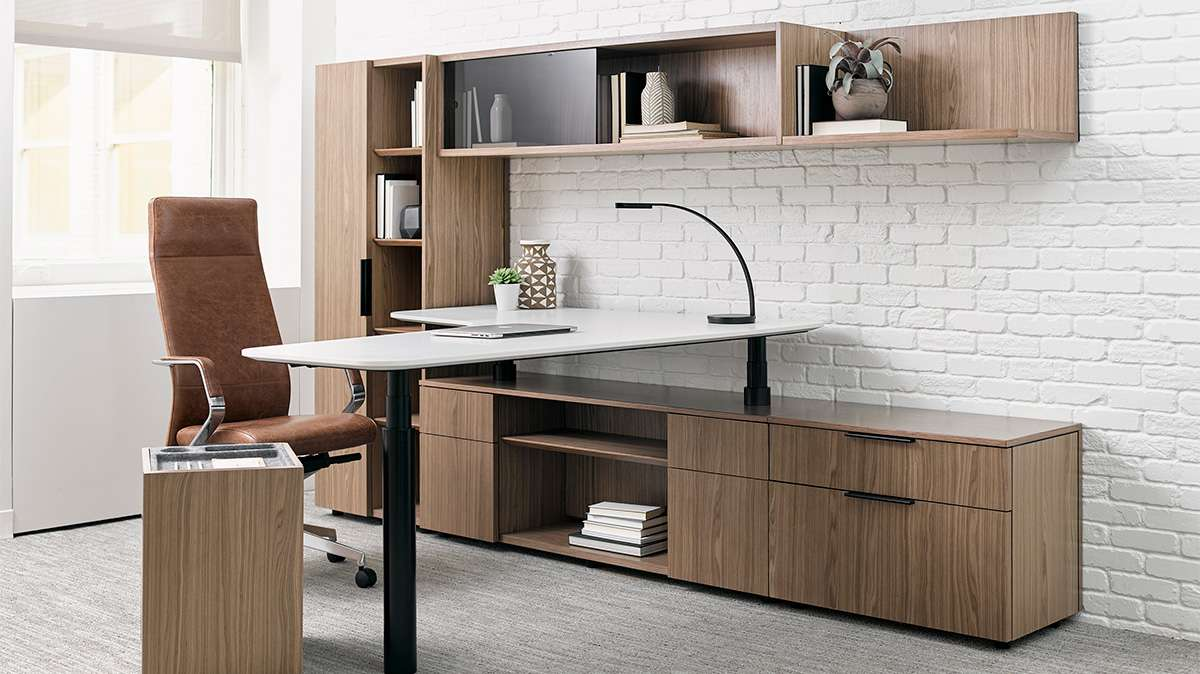 unique adjustable desktop layered on top of file  cabinets for increased flexibility