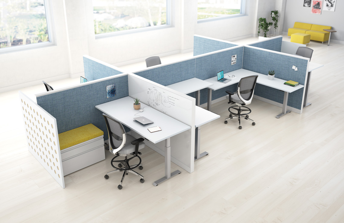 a cluster of desks that adjust to a height that is most productive for the worker