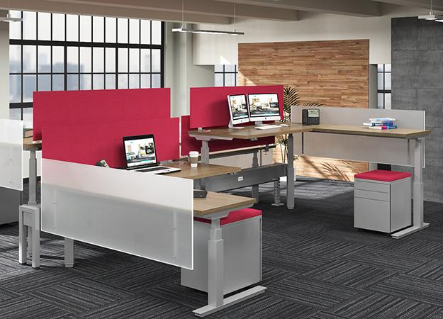 work space with desks and returns that adjust  to multiple heights