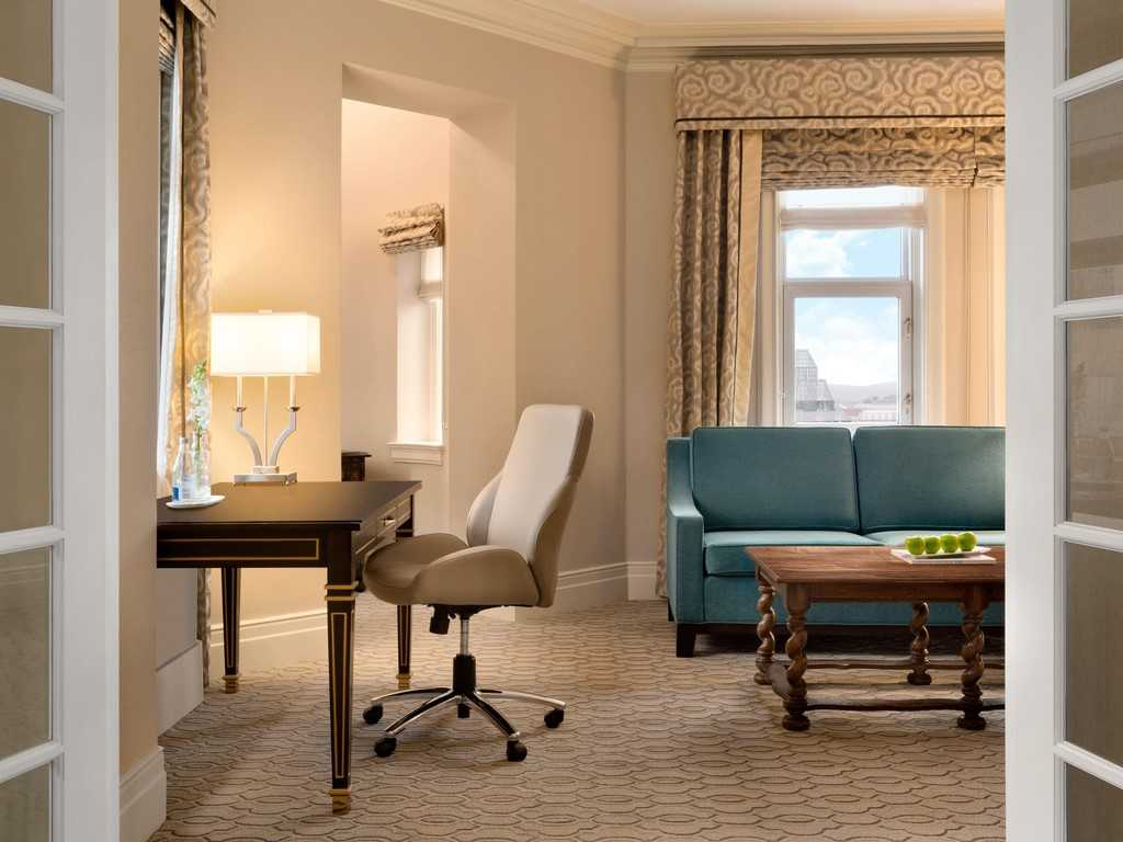lounge and workspace in hotel environment with sofa desk and comfortable work chair