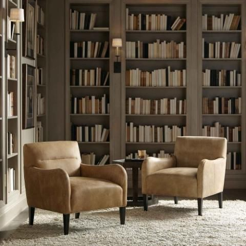 cozy library style collaboration area with 2 gold cushioned chairs