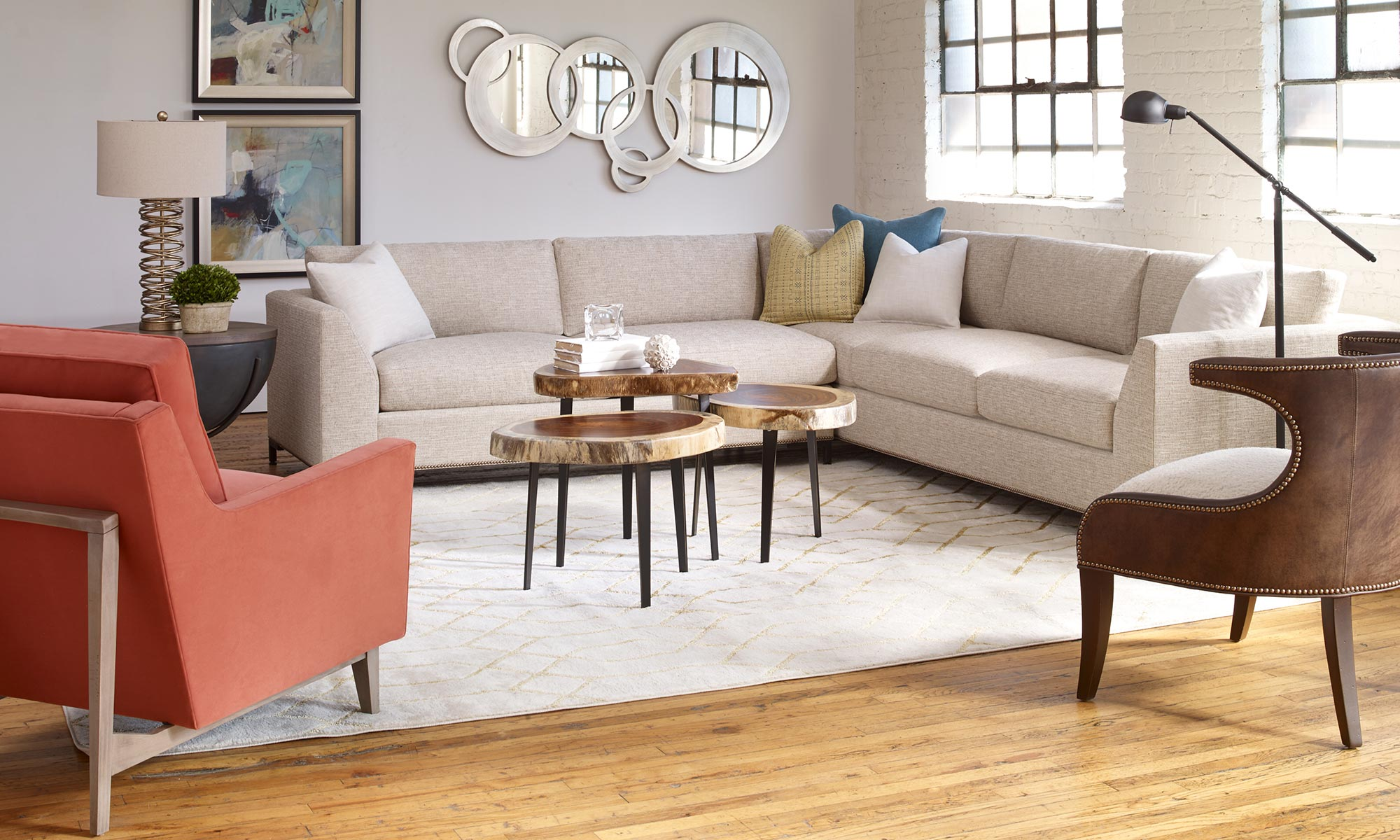 living room style lounge area with sectional chairs side table and lamps
