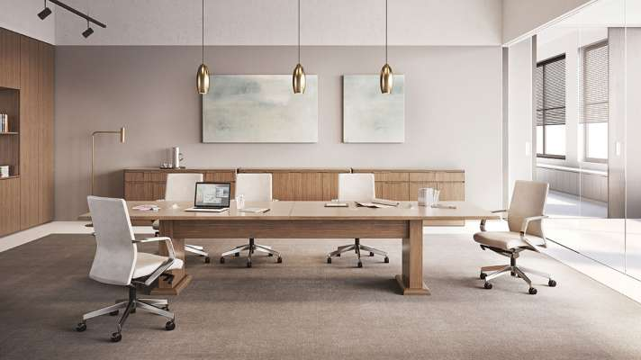 The Meeting Room collection from OFS employs rich wood surfaces  to create a beautifully functional space.