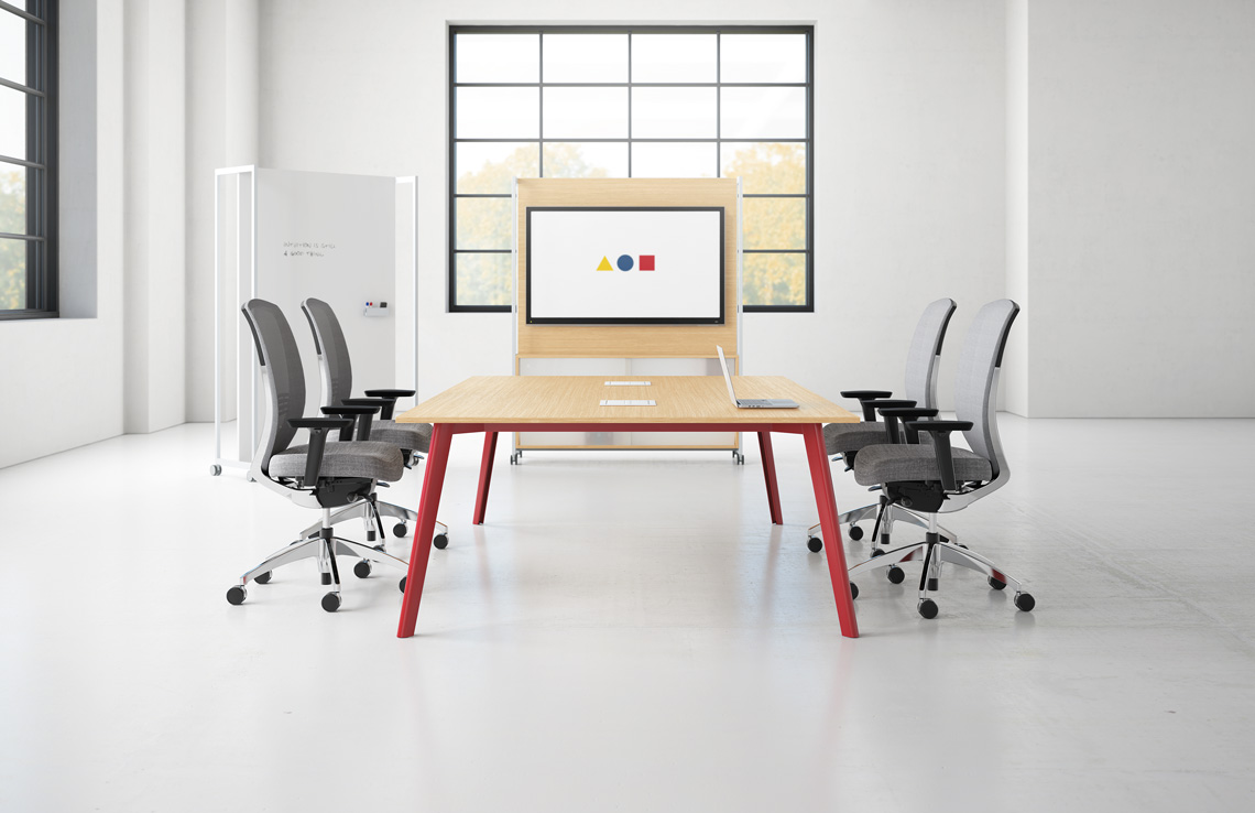 Light wood and red conference table from Kimball Kore . Bauhaus inspired the collection includes round, square and rectangular tables.