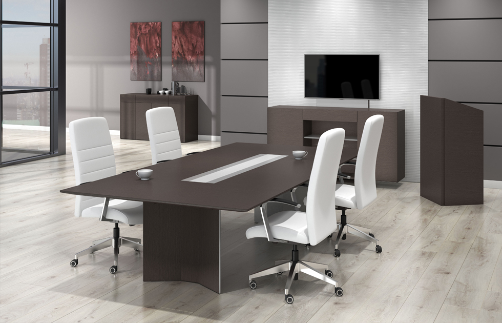 Executive conference/meeting room with dark table and lecturn complimented by white office chairs.